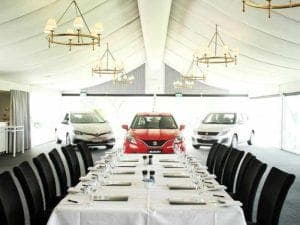 Function venue with cars in room