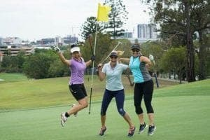 Ladies jumping on the golf course