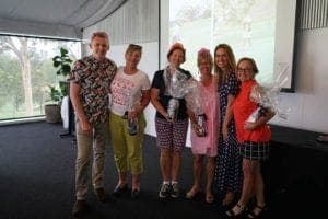 Ladies winning prizes at golf day